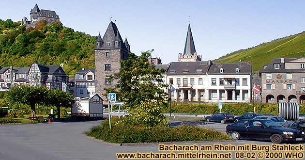 Bacharach on the Rhine River, large parking space on the Rhine River shore, next to the federal highway B9. Ca Stahleck, Marktturm and Peterskirche (Peter's church).